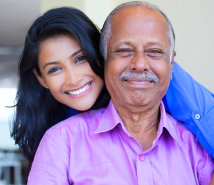 caregiver and old man showing their genuine smile