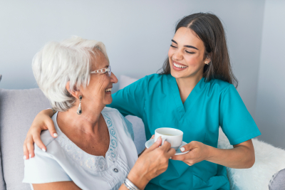 caregiver and her patient having happy moment