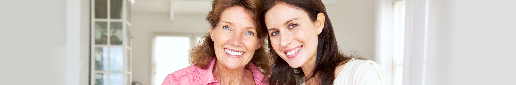 caregiver and old woman showing their genuine smile